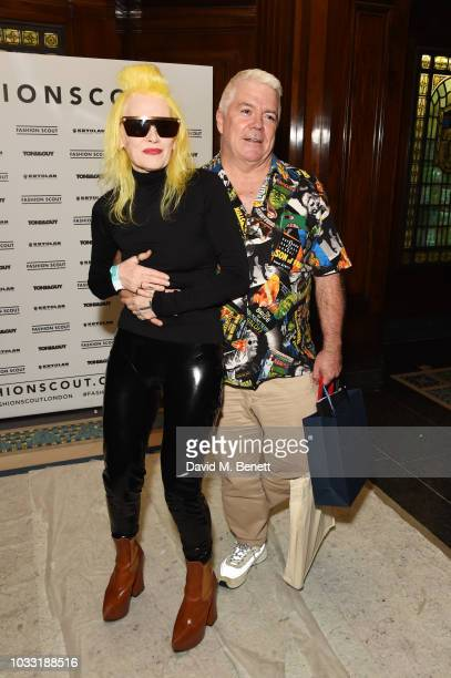Pam Hogg and Tim Blanks pose backstage at the Pam Hogg show during London Fashion Week September 2018 at The Freemason's Hall on September 14 2018 in...