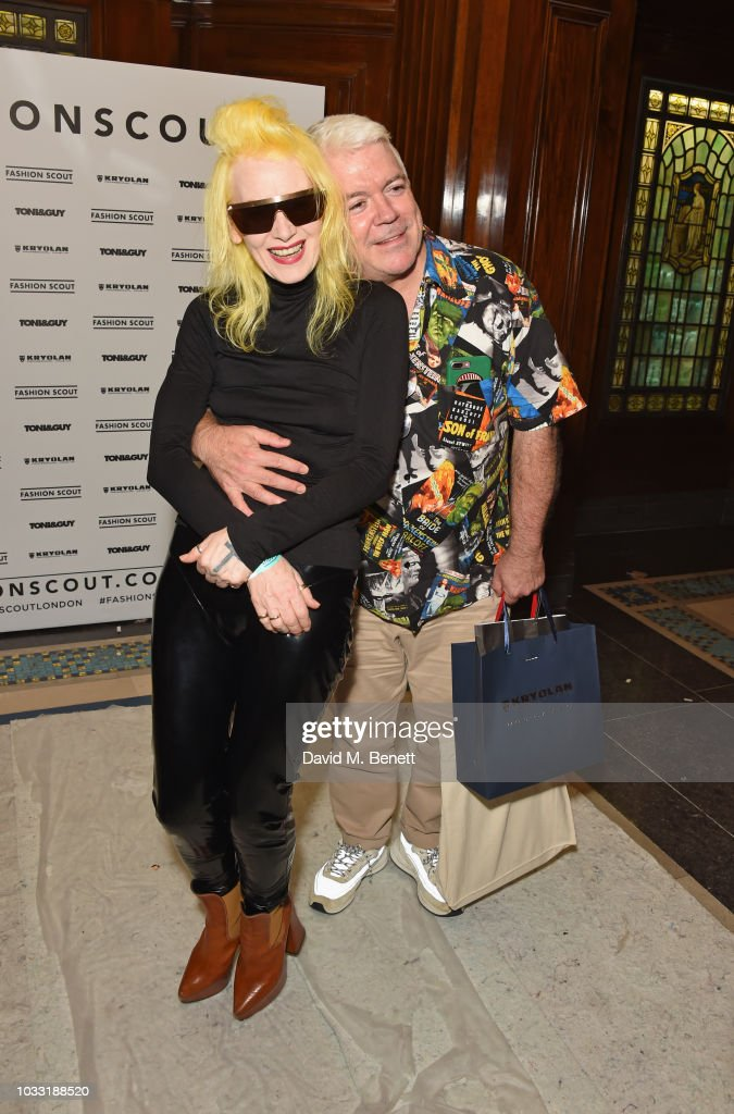 Pam Hogg (L) and Tim Blanks pose backstage at the Pam Hogg show during London Fashion Week September 2018 at The Freemason's Hall on September 14, 2018 in London, England.