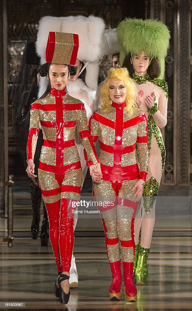 Pam Hogg (R) walks the catwalk during the Pam Hogg show at Freemasons Hall during London Fashion Week Fall/Winter 2013/14 on February 16, 2013 in London, England.