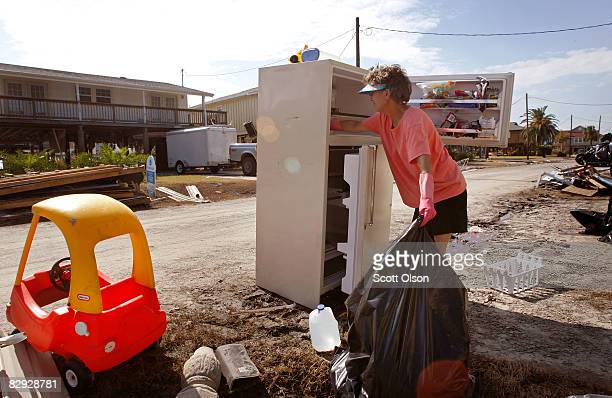 Pam Jones cleans rotting food from her refrigerator after her home was damaged and left without power since Hurricane Ike hit September 20 2008 in...