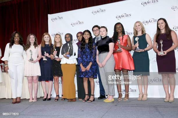 Pam Olivers poses with the recipients of the TV Student Market and Interactive Awards at The Gracies presented by the Alliance for Women in Media...