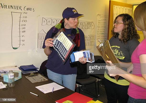 Pam RallJohnston a 43yearold Service Employees International Union volunteer lead organizer Megan Block and Ashley Mathews go over paperwork at the...