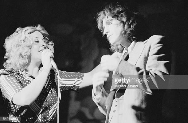 Pam Travis as Andrea and Ray Davies as Norman in a live performance of the Kinks' concept musical 'A Soap Opera' at the New Victoria Theatre London...