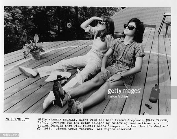 Pamela Adlon and Mary Tanner Bailey sunbathe in a scene from the movie 'Willy/Milly' circa 1986
