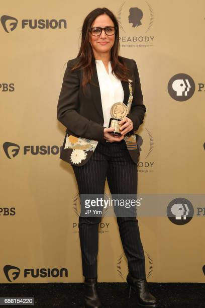 Pamela Adlon poses with an award during The 76th Annual Peabody Awards Ceremony at Cipriani Wall Street on May 20 2017 in New York City