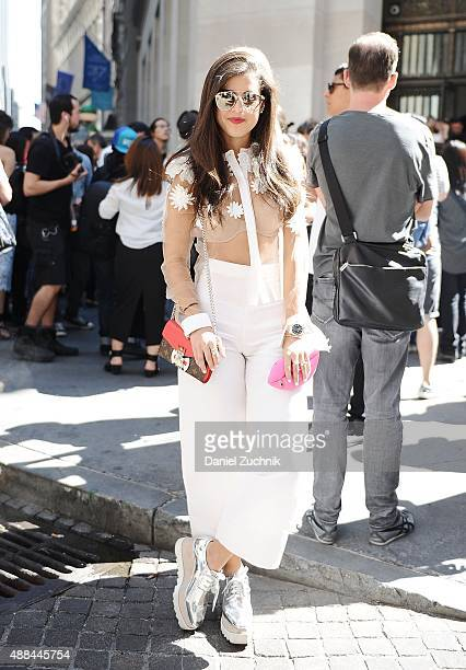 Pamela Allier is seen outside the Diesel Black Gold show wearing a Kris Goyri outfit with Stella McCartney shoes and Dior sunglasses during New York...