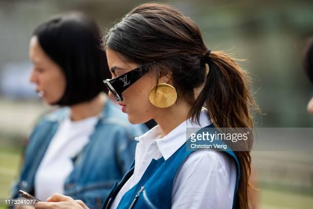 Pamela Allier is seen wearing Louis Vuitton sunglasses, golden earring outside Tory Burch during New York Fashion Week September 2019 on September...