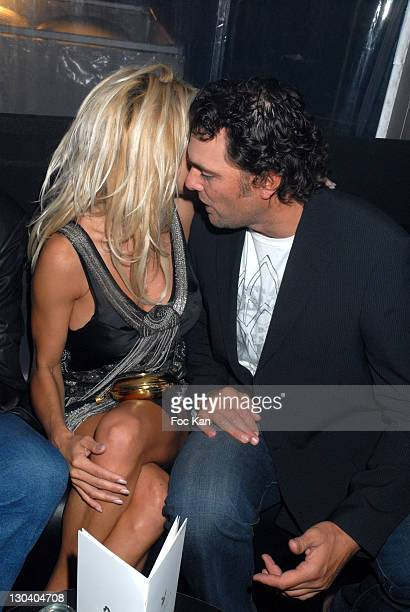Pamela Anderson and A Guest during 2007 Cannes Film Festival Pamela Anderson Party at VIP Room Palm Beach in Cannes France