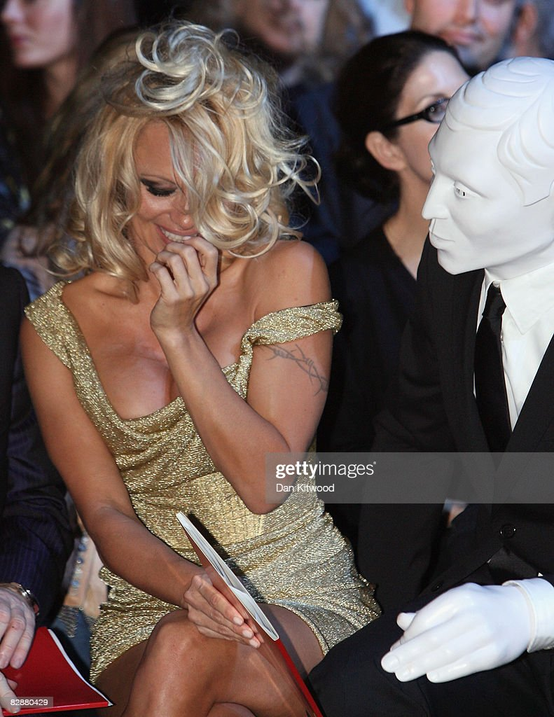 Pamela Anderson and a mystery man attends the Vivienne Westwood Spring/Summer 2009 collection catwalk during London Fashion week on September 18, 2008 in London, England.