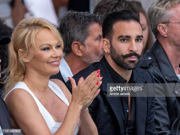 Pamela Anderson and Adil Rami attend Amber Lounge 2019 Fashion Show on May 24 2019 in MonteCarlo Monaco