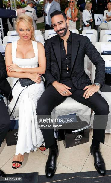 Pamela Anderson and Adil Rami attend Amber Lounge U*NITE Fashion Monaco 2019 at Le Meridien Beach Plaza Hotel on May 24 2019 in Monaco Monaco
