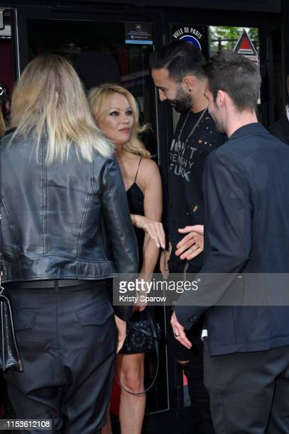 Pamela Anderson and Adil Rami attend the Bionic ShowGirl Premiere at Le Crazy Horse on June 03 2019 in Paris France