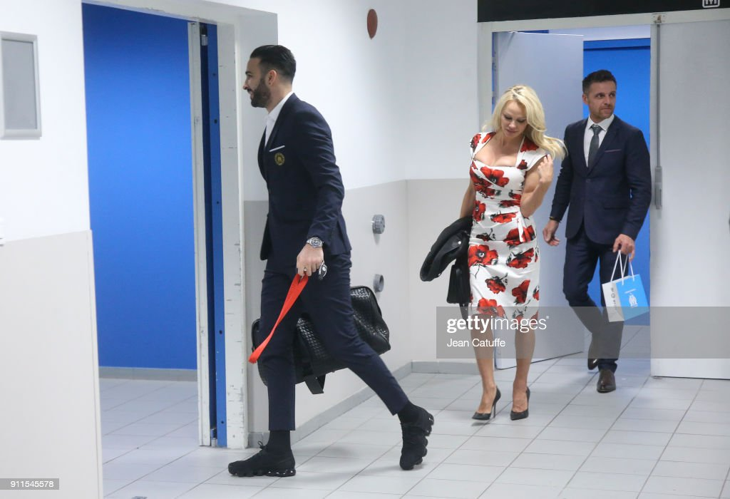 pamela anderson and adil rami of om leave the stadium following the