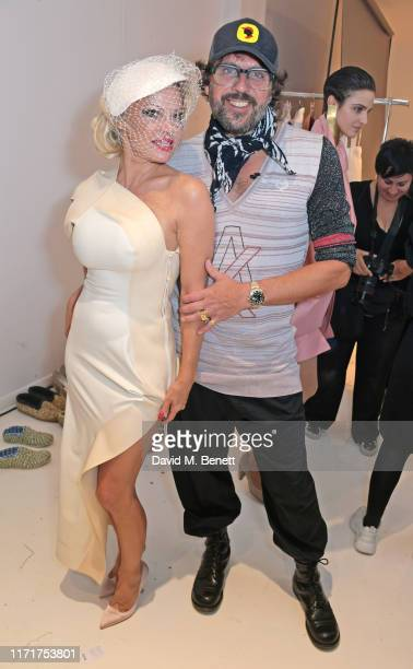 Pamela Anderson and Andreas Kronthaler attend the Andreas Kronthaler For Vivienne Westwood Womenswear Spring/Summer 2020 show as part of Paris...