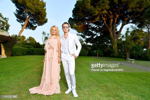 Pamela Anderson and Brandon Lee attend the amfAR Cannes Gala 2019 at Hotel du Cap-Eden-Roc on May 23, 2019 in Cap d'Antibes, France.