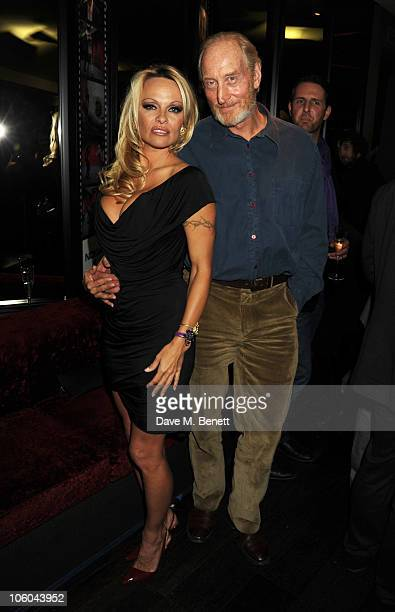 Pamela Anderson and Charles Dance attend the film premiere of 'The Commuter' a film shot on the new Nokia N8 at Aqua London on October 25 2010 in...