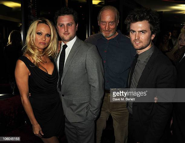 Pamela Anderson and Charles Dance with Rory and Ed McHenry attend the film premiere of 'The Commuter' a film shot on the new Nokia N8 at Aqua London...