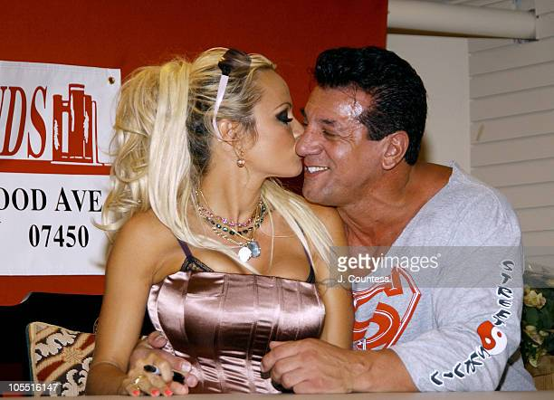 Pamela Anderson and Chuck Zito during Pamela Anderson Signs Copies of her New Book Star A Novel August 3 2004 at Book Ends in Ridgewood New Jersey...