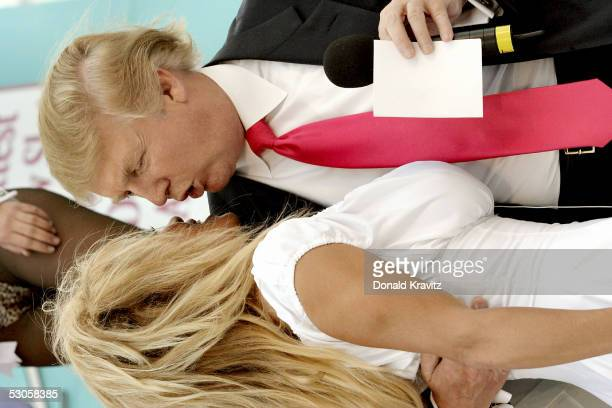 Pamela Anderson and Donald J Trump chat as they attend a special 'Donald J Trump Birthday Quarter Million Dollar Giiveaway' celebration June 11 2005...