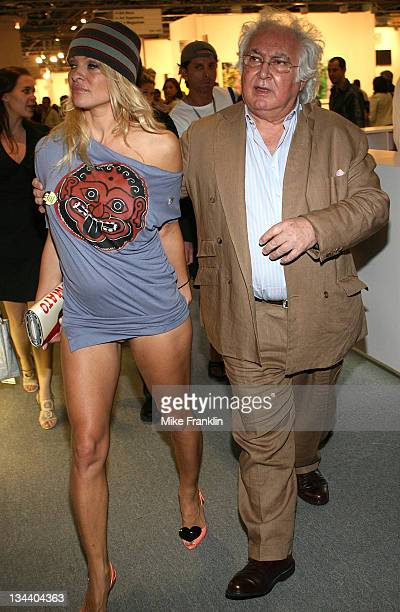 Pamela Anderson and gallery owner Tony Shafrazi attend Art Basel Miami Beach on December 6, 2008 in Miami Beach, Florida.