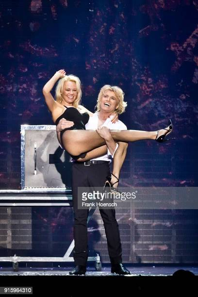 Pamela Anderson and Hans Klok perform live on stage during his show at the Tempodrom on February 8 2018 in Berlin Germany