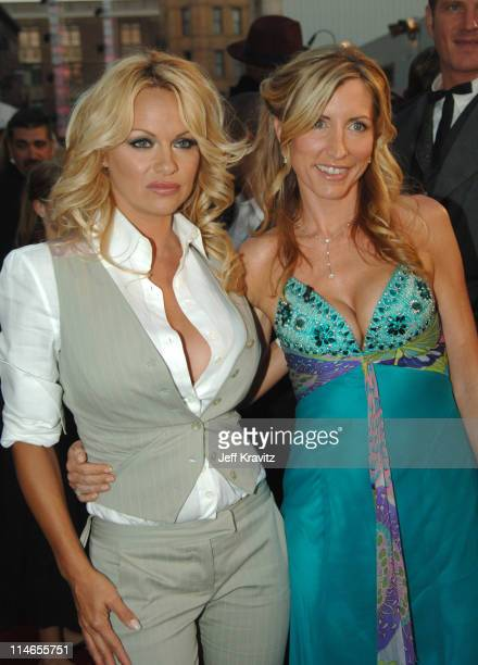 Pamela Anderson and Heather Mills during 25th Anniversary Gala for PETA and Humanitarian Awards Red Carpet at Paramount Pictures in Hollywood...