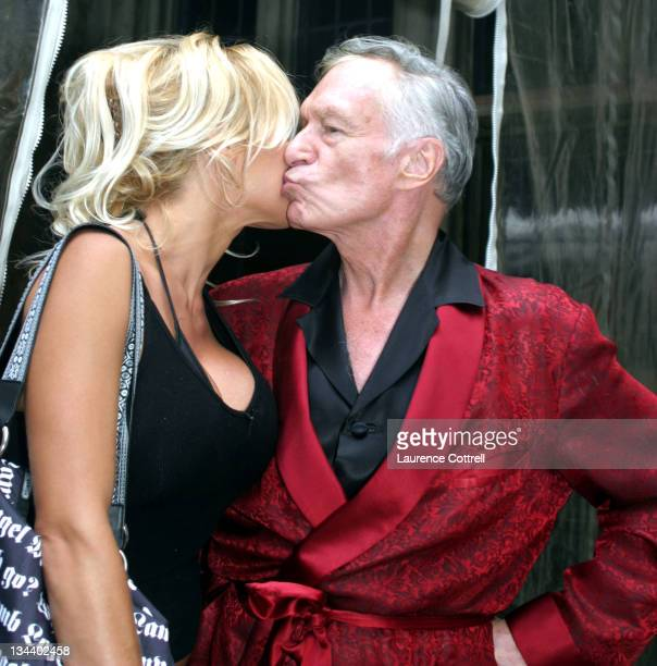 """Pamela Anderson and Hugh Hefner during """"A Day at The Mansion"""" – sponsored by Red Bull Energy Drink and Playboy to celebrate the XGames in Los Angeles..."""