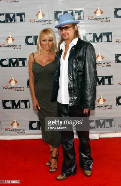 Pamela Anderson and Kid Rock during 2003 CMT Flameworthy Awards Arrivals at The Gaylord Center in Nashville Tennessee United States