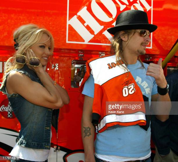 Pamela Anderson and Kid Rock give Winston Cup driver Tony Stewart the thumbs up prior to the start of the Food City 500
