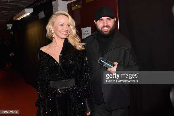 Pamela Anderson and Michael Halpern winner of the British Emerging Talent Womenswear award for Halpern backstage during The Fashion Awards 2017 in...