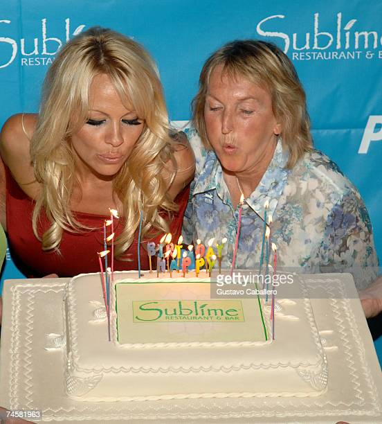 Pamela Anderson and PETA President Ingrid E. Newkirk blow out the candles on her 40th birthday cake at Sublime restaurant where PETA hosted her 40th...