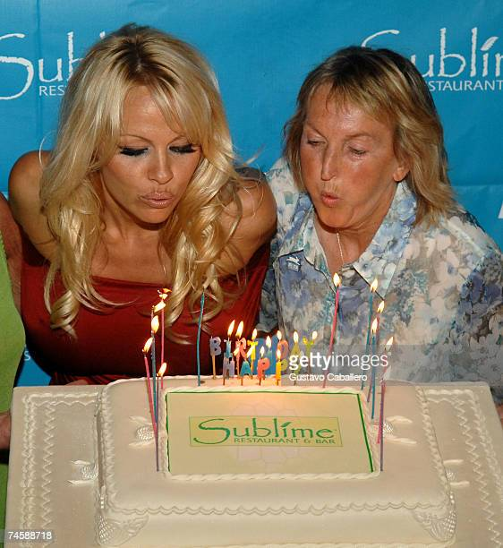 Pamela Anderson and PETA President Ingrid E Newkirk blow out the candles on her 40th birthday cake at Sublime restaurant where PETA hosted her 40th...