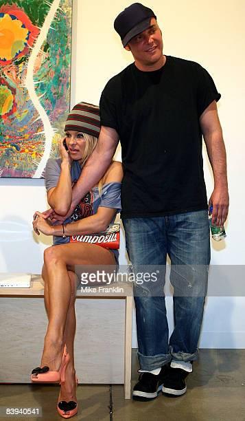 Pamela Anderson and photographer David LaChapelle attend Art Basel Miami Beach on December 6, 2008 in Miami Beach, Florida.
