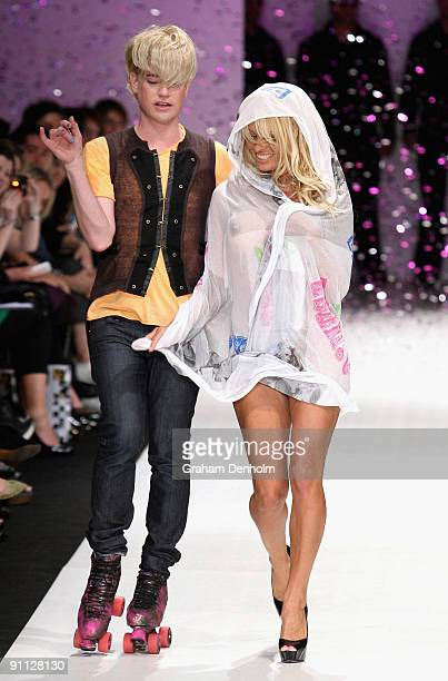 Pamela Anderson and Richie Rich walk the catwalk following the A Muse by Richie Rich collection show on day four of Air New Zealand Fashion Week 2009...