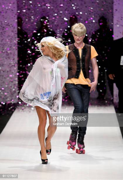 Pamela Anderson and Richie Rich walk the catwalk followoing the A Muse by Richie Rich collection show on day four of Air New Zealand Fashion Week...