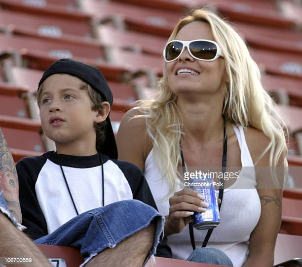 Pamela Anderson and son Brandon Thomas watch the X Games Moto X Freestyle competition at the AL Coliseum in Los Angeles Calif on Saturday August 16...