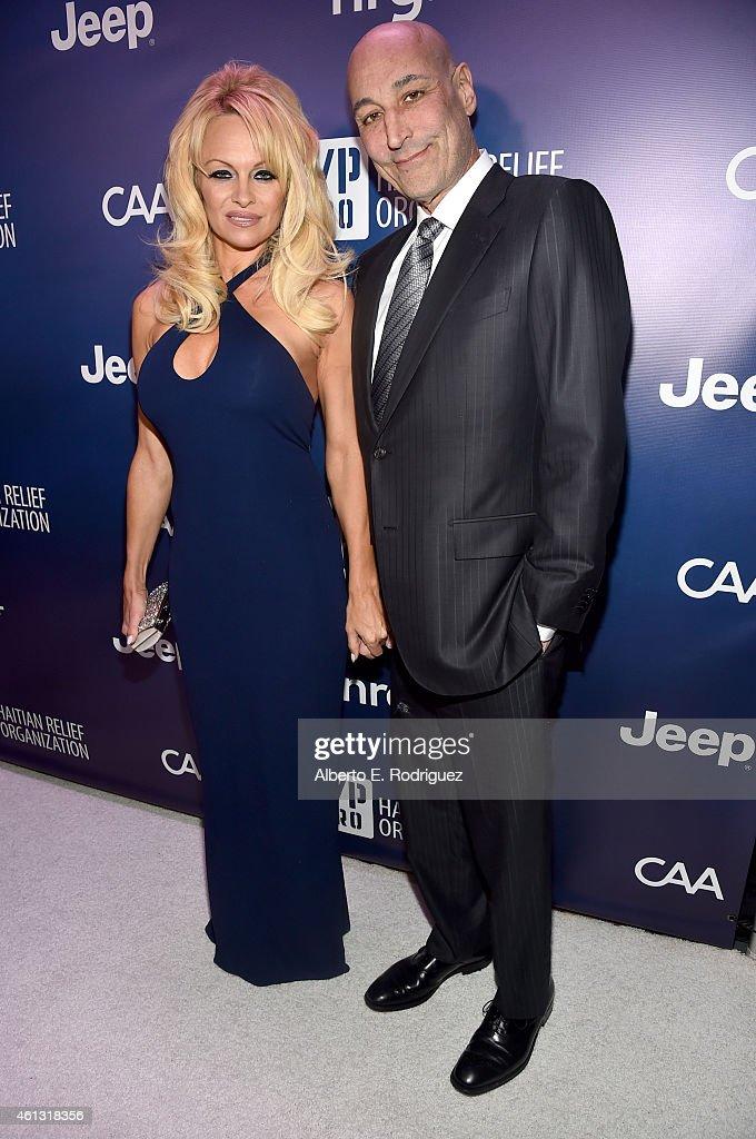 Pamela Anderson and Steve Simon attend the 4th Annual Sean Penn & Friends HELP HAITI HOME Gala Benefiting J/P Haitian Relief Organization on January 10, 2015 in Los Angeles, California.
