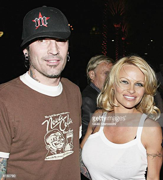 Pamela Anderson and Tommy Lee arrive at the Rodeo Drive Walk of Style Event Honoring Tom Ford on March 28 2004 in Beverly Hills California