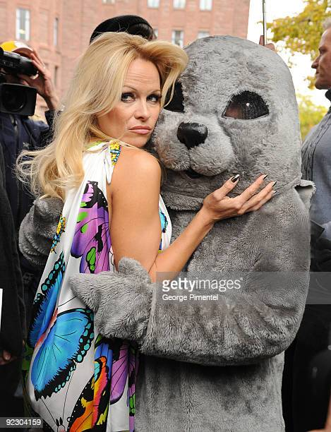 Pamela Anderson appears with a person dressed as a baby seal to unveil a new PETA campaign at the Ontario Legislative Building on October 23 2009 in...