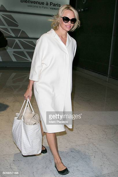 Pamela Anderson arrives at CharlesdeGaulle on January 19 2016 in Paris France