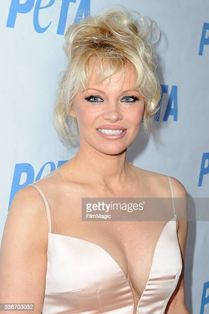 Pamela Anderson arrives at the LA Launch Party for Prince's PETA Song at PETA on June 7 2016 in Los Angeles California
