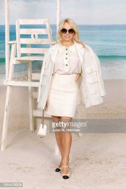 Pamela Anderson attends the Chanel show at Le Grand Palais as part of Paris Fashion Week Womenswear on October 2 2018 in Paris France