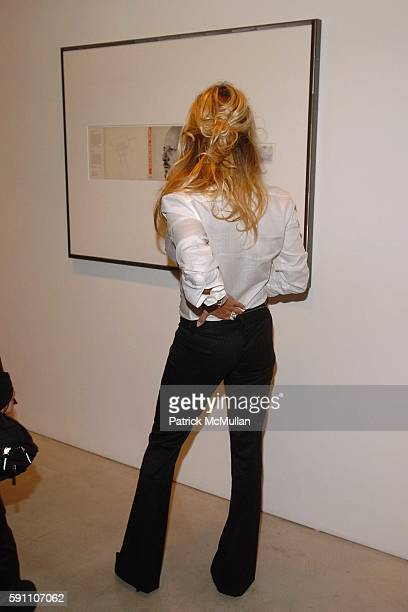 Pamela Anderson attends The Opening Reception of Richard Prince Check Paintings at Gagosian Gallery on February 24 2005 in Beverly Hills California