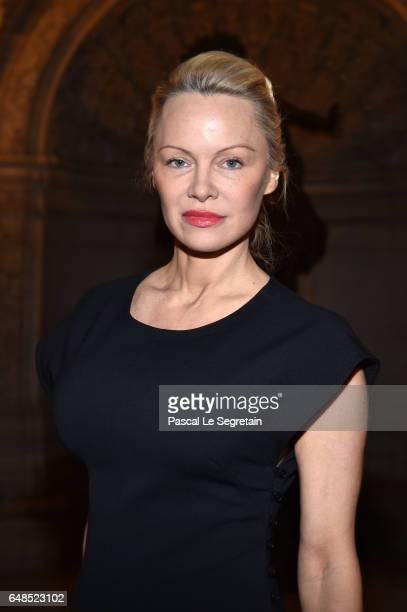 Pamela Anderson attends the Stella McCartney show as part of the Paris Fashion Week Womenswear Fall/Winter 2017/2018 on March 6 2017 in Paris France