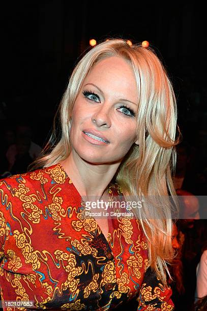 Pamela Anderson attends the Vivienne Westwood show as part of the Paris Fashion Week Womenswear Spring/Summer 2014 at Le Centorial on September 28...
