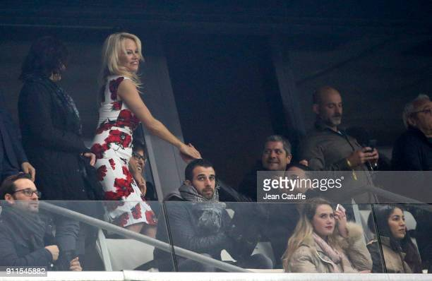 Pamela Anderson celebrates the goal of boyfriend Adil Rami after 7 minutes into the match during the French Ligue 1 match between Olympique de...