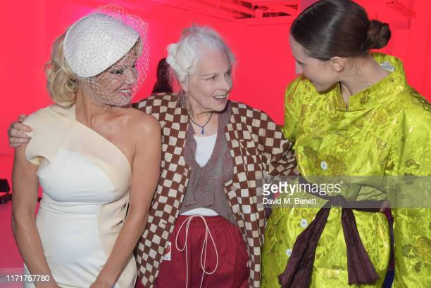 Pamela Anderson Dame Vivienne Westwood and Anna Cleveland attend the Andreas Kronthaler For Vivienne Westwood Womenswear Spring/Summer 2020 show as...