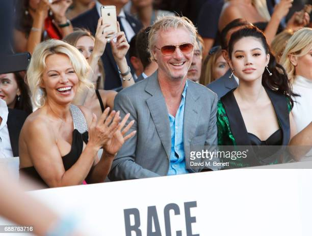 Pamela Anderson Eddie Irvine and Jolie Nguyen attend the Amber Lounge Fashion Monaco 2017 at Le Meridien Beach Plaza Hotel on May 26 2017 in Monaco...