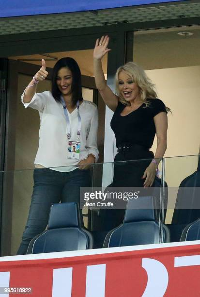 Pamela Anderson girlfriend of Adil Rami of France celebrates with a friend the victory following the 2018 FIFA World Cup Russia Semi Final match...