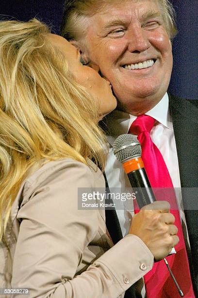 Pamela Anderson kisses Donald J Trump as they attend a special Donald J Trump Birthday Quarter Million Dollar Giiveaway celebration June 11 2005 in...